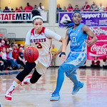 Miah Spencer dribbling past a UNC guard in NC State's win over UNC-Chapel Hill.