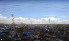 Electric Poverty Square (Sid da' Cool) Tags: mumbai maharashtra india in wadala antop hill antophill antophillslums slums powerlines electricity slum highvoltagepowerpole highvoltagepower highvoltage powerpoles flickrfriday square