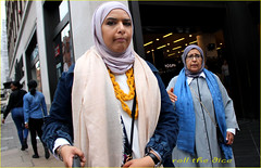 `1824 (roll the dice) Tags: london westminster w1 oxfordstreet marblearch westend islam muslim veiled burka hijab mad sad funny pretty sexy girl madness religion fashion shops shopping people natural eyes brave face streetphotography uk classic art urban unaware unknown england portrait stranger candid selfie glasses canon tourism oil arab