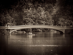 Once Upon a Time (Explore, October 14) (Mildred Alpern) Tags: centralpark bowbridge lake outdoors trees rowboat man woman sepia