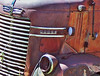 Dodge COE (Jeff M Photography) Tags: old orange tractor art abandoned rural truck vintage junk rust antique farm ruin faded chrome rig dodge junkyard chrysler heavy coe dents relic bigrig cabover caboverengine