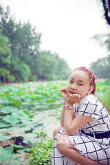 Child#23 (K2 Sue) Tags: flowers cute girl beautiful smile forest photography child dress sweet longhair multicolored hairpin whitedress toothysmile 7years colorimage focusonforeground chineseethnicity