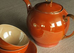 Secrets of a tea set (alideniese) Tags: stilllife orange reflection closeup shiny teapot colourful teaset burntorange chinaware lustrous lustreware cupsandsaucers victoriaczechoslovakia