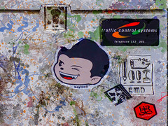 Uncontrolled Traffic (Steve Taylor (Photography)) Tags: lock trafficcontrol systems bmd australia boywolf splatter telephone werewolf teeth wink pencil pig head face palm tree pot art digital graffiti logo painting sticker pasteup wheatup wheatpaste streetart colourful weird crazy mad odd strange boy lad newzealand nz southisland canterbury christchurch cbd city texture cabinet