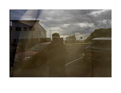 Vacant storefront with brown paper in window (Richard C. Johnson: AKA fishwrapcomix) Tags: leicaq summiluxf17 28mm paxamericanus endofempire digital civisromanussum duluth minnesota thegreatrecession economicdownturn window reflections selfportrait storefront sunsetsinthewest sunrisesintheeast outdoor whiteborder vehicles car minivan lakesuperior clouda bricks tarmack parking