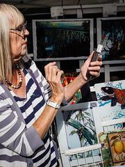 SMART PHONE, SMART CARD.....CHARGE IT !  __P9090151.jpg (Marc Weinberg) Tags: streetscenes streetshooter woman merchant market artsandcrafts technilogy smartphone smartcards chargeit sales streetmarket