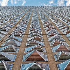Field of Crystals (Paul Brouns) Tags: glass facade geometry architecture wall perspective square paulbrouns paulbrounscom paul brouns milan milano      urban pattern repetition looking up sky triangles crystal crystals windows lines aligned variations