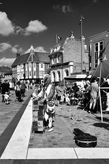 Sylvester The Jester. (Cycling Saint) Tags: leicesterfestival nikond750nikkor2470f28 monochrome blackandwhite people leicester streetentertainment