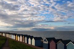 Herne Bay huts (NovemberAlex) Tags: colour clouds seaside hernebay kent water beachhuts