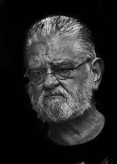 Portrait (D80_457659) (Itzick) Tags: nycsep2016 blackbackground man face portrait candid itzick d800 glasses beard bwportrait