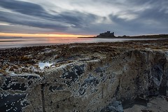 Castle rocks sunrise (Carl Mick) Tags: sky longexposure sea eastcoast northeast sunrise robferrol ngc seascape castle northumberland clouds leefilters coast bamburghsunriseseascapecastle northeastcoast rocks sand