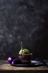 Eggplants (saraghedina) Tags: foodphotography foodstyling chiaroscuro stilllife stilllifephotography eggplant purple vegetable vertical nopeople canon 100mm raw rustic