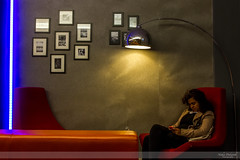 Blue and Orange (Nathan Dodsworth Photography) Tags: colour light portraiture lamp seating telephone relaxing candid bar photographs wall shadows neon indoors female woman
