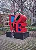 Climbing the LOVE statue