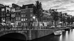 Amsterdam Style (McQuaide Photography) Tags: amsterdam noordholland northholland netherlands nederland holland dutch europe sony a7rii ilce7rm2 alpha mirrorless 1635mm sonyzeiss zeiss variotessar fullframe mcquaidephotography lightroom adobe photoshop tripod manfrotto light licht water unesco heritage stad city urban lowlight architecture outdoor outside waterfront gracht capitalcity capital building bridge brug canal boat authentic classic blackandwhite blackwhite bw mono monochrome longexposure 169 widescreen panoramic spiegelgracht prinsengracht boot canalhouse corner hoek wideangle wideanglelens groothoek