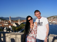 Sean & Nina at Kamerlengo Fortress in Trogir. Croatia Summer 2016 (seanfderry-studenna) Tags: nina kamerlengo castle fort fortress trogir croatia hrvatska serb stone woman female girl lady girlfriend fiancee wife married beauty gorgeous stunning beautiful white dress summer august 2016 holiday vacation long dark hair brunette handbag face shoulders arms tan tanned sun sunshine hot shade shadows legs feet sandals sunglasses tourist exploring old fortification history sean couple love hug together happy smile smiling pose candid