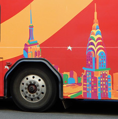 Tour-bus art (TheMachineStops) Tags: outdoor 2016 bus wheel vibrant colorful vehicle esb empirestatebuilding chryslerbuilding spire nyc newyorkcity manhattan tire