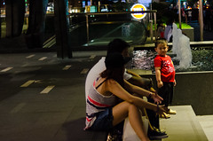 Disapproval (isparavanje) Tags: street people night kid singapore couple streetphotography d5100