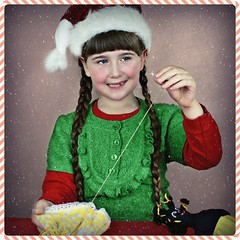 Sewing Christmas Elf (Portrait Central) Tags: santa lighting christmas xmas pink portrait brown holiday snow black green thread girl hat shop photoshop work hair studio children photography photo costume outfit holidays doll long dolls photographer santas child hand dress little handmade sewing central young craft ears fringe sew professional made elf cotton needle photograph workshop backdrop seamstress bangs plaits wog tailor golly helper gollywog golliwog picmonkey