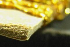 a cardboard  card of rick-rack (muffett68 ) Tags: macromonday card zigzag rickrack bokeh gold