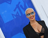 Model Amber Rose arrives for the 2016 MTV Video Music Awards August 28, 2016 at Madison Square Garden in New York. / AFP / Angela Weiss (Photo credit should read ANGELA WEISS/AFP/Getty Images)