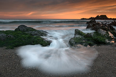 Early Doors (Des Daly) Tags: longstrand sunset water wave rocks beach movement cork west