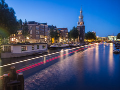 Montelbaanstoren light trails (northcountrygirl) Tags: amsterdam city netherlands canal lighttrails lightstreams boat montelbaanstoren sigma1020