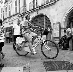 I want to ride my bicycle. (Neil. Moralee) Tags: neilmoralee bicycle woman ride rider pedal street candid black white bw monochrome mono blackandwhite outdoor people nikon d7100 18300mm bike neil moralee leg legs power skirt bocage watch watching