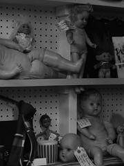 IMG_1014 (asherwilcox) Tags: photography bnw bw blackandwhite bandw spooky antiques contrast dslr old retro vintage architecture buildings doll dolls toys orange colors blue raisins strange esoteric ubuquitous light dark kansascity city film