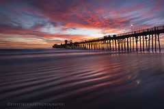 Ignition (sjs61) Tags: sjs61 steveskinnerphotography steveskinner surf sunsets seascape slowexposure sand reflections reflectedlight oceansidepier waves water beach