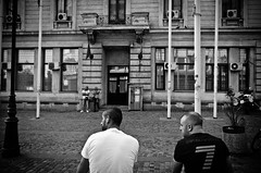 That'll Be Us in Another Fifteen Years, Bro (stimpsonjake) Tags: nikoncoolpixa 185mm streetphotography bucharest romania city candid blackandwhite bw monochrome men young old future centrulvechi guys
