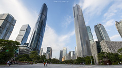 Guangzhou, China - Oct 13 2016: Unidentifier people walk in front of the Guangzhou Opera House, skyscrapers and other modern buildings at the Zhujiang New Town, China. (nattapan.suwansukho) Tags: architectural architecture asia asian building business canton center china chinese city cityscape commercial contemporary design district downtown exterior famous finance financial guangdong guangzhou house landmark landscape light metropolis metropolitan modern new night office opera pearl scene skyscraper structure tourism town travel urban zhujiang