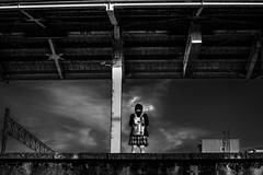 Platform One (Scott F Thompson) Tags: uozu japan station trainstation platform waiting girl adidas backpack blackandwhiite streetphotography student skirt uniform school