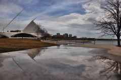 Milwaukee Art Museum (Seth Oliver Photographic Art) Tags: wisconsin clouds reflections landscapes iso200 nikon cityscapes lakemichigan milwaukeeartmuseum milwaukee museums pinoy santiagocalatrava circularpolarizer urbanscapes downtownmilwaukee d90 wetreflections manualmodeexposure setholiver1 aperturef130 1024mmtamronuwalens 1200secondexposure