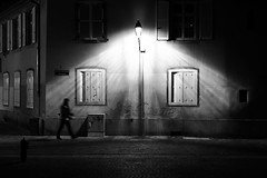 I might have scared him... (Elios.k) Tags: street windows light people blackandwhite house man france lamp silhouette horizontal wall night dark walking outdoors person one movement alone pattern post walk strasbourg petitefrance littlefrance monom pixopolitan