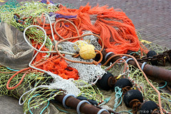 Beauty of the fishing nets I (imke!!) Tags: blue orange holland net netherlands colors yellow fishing bright harbour fishnet rope nets hafen ijsselmeer fsh
