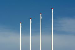 Rhyttm of four flagstaffs (Jan van der Wolf) Tags: map156301v flagpole plagstaff four minimalism rhythm herhaling repetition vlaggemast ritme visualrhythm red rood redrule sky