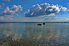 es gibt momente der Stille (Wunderlich, Olga) Tags: wasser rgen insel deutschland boote spiegelung himmel wolken landscape natur naturschutzgebiet sand strand