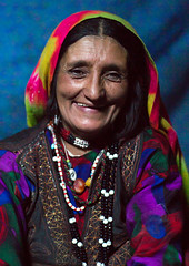 Portrait of a smiling afghan woman in pamiri traditional clothing, Badakhshan province, Khandood, Afghanistan (Eric Lafforgue) Tags: 4044years adult adultsonly afghan afghan512 afghani afghanistan anthropolgy badakhshanprovince centralasia colourimage community headscarf indigenousculture indoors ismaili khandood lifestyles lookingatcamera matureadult multicoloured necklace oneperson oneseniorwomanonly onewomanonly onlywomen photography portrait poverty senioradult seniorwomen smiling traditionalclothing veil vertical waistup wakhan wakhi women womenonly pamir