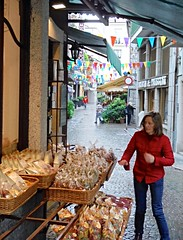 Stresa (Lydie's) Tags: sweets businesses shopkeeper stresa italy bunting baskets awning