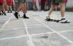 Group exercise in shackles after morning roll call in prison (asiancuffs) Tags: handcuffs handcuffed shackles shackled prisoner inmate