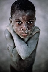 01d9b8ca674acb765630118c9376d57c (robert.swartwout) Tags: 1987 africa african timbuktu mali vertical portrait outdoors outside exterior child kid young boy stand standing armscrossed cover covered covering dust dusty dirt dirty powder mud nude naked nyc9468 mcs1987002k100 0005503 africa10018 mali10004