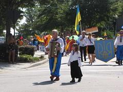 (Gerry Dincher) Tags: internationalfolkfestival parade fayetteville cumberlandcounty northcarolina downtownfayetteville personstreet haystreet marketsquare accordian grandfather grandpa grandchild ukrainian