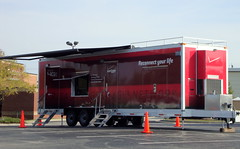 Verizon Reconnect Your Life Trailer. (dccradio) Tags: lumberton nc northcarolina robesoncounty hurricanematthew relief aftermath hurricane matthew stormrelief chargingstation verizon reconnectyourlife trailer pylon cone steps portable internetaccess emailaccess news information tree trees pavement parkinglot lowes