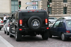 Hummer on the streets of Paris, with a SmartCar just in front of it (janeymoffat) Tags: cars hummer smartcar paris france