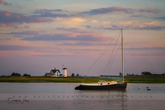 Oyster River Sunset (betty wiley) Tags: capecod chatham stageharborlighthouse summer catboat sunset massachusetts newengland marsh river bettywileyphotography ocean light