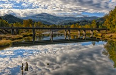 Reflections (Philip Kuntz) Tags: reflections luminous radiance mirror bridge i90bridge coeurdaleneriver cataldo idaho autumn fallfoliage notanhdr