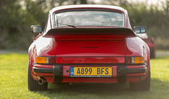 Rear of the Year...... (kevaruka) Tags: porsche porsche911 porscheclubgb griffinshead not papplewick classiccar classiccarshow porsche91132carrera carrera 32 guardsred se carrerase sport coup 1983 primelens canonef135f2l canon canoneos5dmk3 canon5dmk3 carshow 5d3 5diii 5dmk3 5d red sun sunshine sunnyday sunny evening kevinfrost twilight september 2016 england sportscar aircooled nottinghamshire flickr frontpage thephotographyblog photography prime bokeh dof green front rear