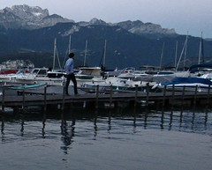 Lake Annecy (AmyEAnderson) Tags: lake annecy france europe spring lakefront man walking hipster marina boats mountains foothills snowcapped reflection chic evening twilight