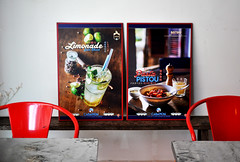 Red chairs (Roving I) Tags: chairs metal tables cafes decor design posters cabanon danang vietnam